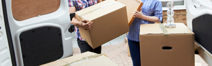 young couple packing a van on their moving day